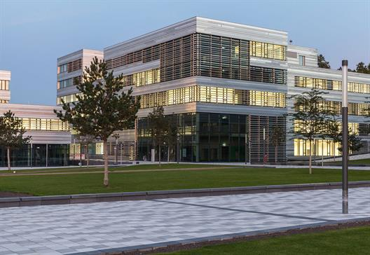 You see one of the new buildings of the University of Applied Sciences Düsseldorf, walkways and greenway.